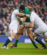 18 March 2017; Robbie Henshaw of Ireland is tackled by Joe Marler, left, and Joe Launchbury of England during the RBS Six Nations Rugby Championship match between Ireland and England at the Aviva Stadium in Lansdowne Road, Dublin. Photo by Sam Barnes/Sportsfile