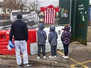 20 March 2017; Members of the public pay their respect as a Derry City FC jersey is pinned to the fence outside the Brandywell Stadium, which is currently under construction, to the late Derry City captain Ryan McBride, who passed away suddenly at the age of 27. The Brandywell Stadium, Derry. Photo by Oliver McVeigh/Sportsfile