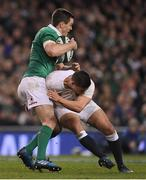 18 March 2017; Jonathan Sexton of Ireland is tackled by Ben Youngs of England during the RBS Six Nations Rugby Championship match between Ireland and England at the Aviva Stadium in Lansdowne Road, Dublin. Photo by Brendan Moran/Sportsfile
