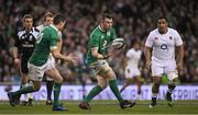 18 March 2017; Peter O'Mahony of Ireland passes to team-mate Jonathan Sexton during the RBS Six Nations Rugby Championship match between Ireland and England at the Aviva Stadium in Lansdowne Road, Dublin. Photo by Brendan Moran/Sportsfile