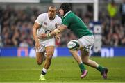 18 March 2017; Jonathan Joseph of England is tackled by Robbie Henshaw of Ireland during the RBS Six Nations Rugby Championship match between Ireland and England at the Aviva Stadium in Lansdowne Road, Dublin. Photo by Brendan Moran/Sportsfile