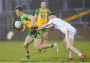 18 March 2017; Eoghan Ban Gallagher of Donegall in action against Declan McClure of Tyrone during the Allianz Football League Division 1 Round 5 match between Donegal and Tyrone at MacCumhaill Park in Ballybofey, Co Donegal. Photo by Oliver McVeigh/Sportsfile