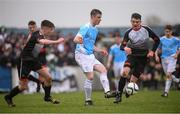 22 March 2017; Peter Corcoran of Rice College in action against Ger O'Mahony, left, and Sean Hillard of St. Francis College during the Bank of Ireland FAI Schools Dr. Tony O'Neill Senior Cup National Final match between Rice College, Westport, and St. Francis College, Rochestown, at Home Farm FC in Whitehall, Dublin. Photo by Stephen McCarthy/Sportsfile