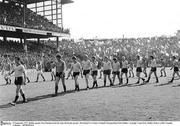 25 September 1977; Dublin captain Tony Hanahoe leads his team during the parade. All Ireland GAA Senior Football Championship Final, Dublin v Armagh, Croke Park, Dublin. Picture credit: Connolly Collection  / SPORTSFILE