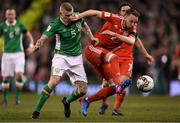 24 March 2017; Chris Gunter of Wales in action against James McClean of Republic of Ireland during FIFA World Cup Qualifier Group D match between Republic of Ireland and Wales at the Aviva Stadium in Dublin. Photo by Brendan Moran/Sportsfile