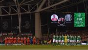24 March 2017; The teams take part in a minute's applause in tribute of the late Ryan McBride of Derry ahead of the FIFA World Cup Qualifier Group D match between Republic of Ireland and Wales at the Aviva Stadium in Dublin. Photo by Ramsey Cardy/Sportsfile