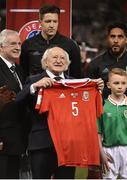 24 March 2017; President of Ireland, Michael D. Higgins is presented with a Wales national soccer jersey with the number 5 on it, in memory of Derry City captain Ryan McBride prior to the FIFA World Cup Qualifier Group D match between Republic of Ireland and Wales at the Aviva Stadium in Dublin. Photo by David Maher/Sportsfile