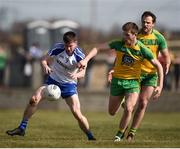 26 March 2017; Karl O'Connell of Monaghan in action against Eoghan Ban Gallagher of Donegal during the Allianz Football League Division 1 Round 6 match between Donegal and Monaghan at Fr. Tierney Park in Ballyshannon, Co. Donegal. Photo by Philip Fitzpatrick/Sportsfile
