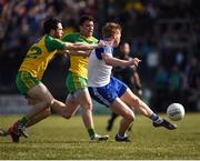 26 March 2017; Kieran Hughes of Monaghan in action against Eóin McHugh of Donegal during the Allianz Football League Division 1 Round 6 match between Donegal and Monaghan at Fr. Tierney Park in Ballyshannon, Co. Donegal. Photo by Philip Fitzpatrick/Sportsfile