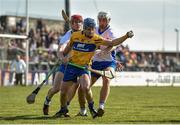 26 March 2017; Podge Collins of Clare in action against Tadhg de Burca, left, and Shane Fives of Waterford during the Allianz Hurling League Division 1A Round 5 match between Clare and Waterford at Cusack Park in Ennis. Photo by Diarmuid Greene/Sportsfile