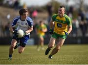 26 March 2017; Jack McCarron of Monaghan in action against Neil McGee of Donegal during the Allianz Football League Division 1 Round 6 match between Donegal and Monaghan at Fr. Tierney Park in Ballyshannon, Co. Donegal. Photo by Philip Fitzpatrick/Sportsfile