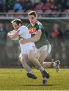 26 March 2017; Ronan McNabb of Tyrone  in action against Lee Keegan of Mayo  during the Allianz Football League Division 1 Round 6 match between Tyrone and Mayo at Healy Park in Omagh. Photo by Oliver McVeigh/Sportsfile