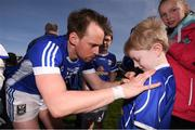 26 March 2017; Sean Johnston of Cavan signs the jersey of young Cavan supporter Dylan Bough, age 7, following the Allianz Football League Division 1 Round 6 match between Cavan and Kerry at Kingspan Breffni Park in Cavan. Photo by Stephen McCarthy/Sportsfile
