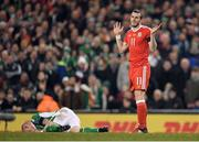 24 March 2017; Gareth Bale of Wales reacts after a tackle on James McClean of Republic of Ireland during the FIFA World Cup Qualifier Group D match between Republic of Ireland and Wales at the Aviva Stadium in Dublin. Photo by Brendan Moran/Sportsfile