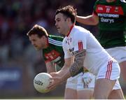 26 March 2017; Cathal McCarron of Tyrone  in action against Andy Moran and Cillian O'Connor of Mayo during the Allianz Football League Division 1 Round 6 match between Tyrone and Mayo at Healy Park in Omagh. Photo by Oliver McVeigh/Sportsfile