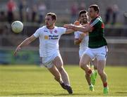 26 March 2017; Niall Sludden of Tyrone in action against Keith Higgins of Mayo  during the Allianz Football League Division 1 Round 6 match between Tyrone and Mayo at Healy Park in Omagh. Photo by Oliver McVeigh/Sportsfile