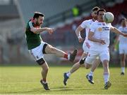 26 March 2017; Kevin McLoughlin of Mayo kicks his sides final point and the winner before Aidan McCrory of Tyrone can get a tackle in during the Allianz Football League Division 1 Round 6 match between Tyrone and Mayo at Healy Park in Omagh. Photo by Oliver McVeigh/Sportsfile