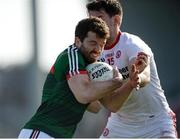 26 March 2017; Chris Barrett of Mayo in action against Matthew Donnelly of Tyrone  during the Allianz Football League Division 1 Round 6 match between Tyrone and Mayo at Healy Park in Omagh. Photo by Oliver McVeigh/Sportsfile