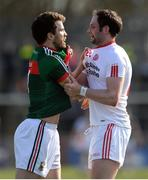 26 March 2017; Chris Barrett of Mayo in dispute with Ronan McNabb of Tyrone  during the Allianz Football League Division 1 Round 6 match between Tyrone and Mayo at Healy Park in Omagh. Photo by Oliver McVeigh/Sportsfile