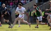 26 March 2017; Cathal McCarron of Tyrone  in action against Kevin McLoughlin of Mayo during the Allianz Football League Division 1 Round 6 match between Tyrone and Mayo at Healy Park in Omagh. Photo by Oliver McVeigh/Sportsfile