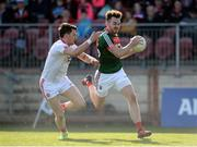 26 March 2017; David Drake of Mayo in action against Matthew Donnelly of Tyrone  during the Allianz Football League Division 1 Round 6 match between Tyrone and Mayo at Healy Park in Omagh. Photo by Oliver McVeigh/Sportsfile