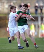 26 March 2017; Diarmuid O'Connor of Mayo  in action against Mark Bradley of Tyrone  during the Allianz Football League Division 1 Round 6 match between Tyrone and Mayo at Healy Park in Omagh. Photo by Oliver McVeigh/Sportsfile