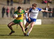26 March 2017; Ciaran Thompson of Donegal in action against Kieran Hughes of Monaghan during the Allianz Football League Division 1 Round 6 match between Donegal and Monaghan at Fr. Tierney Park in Ballyshannon, Co. Donegal. Photo by Philip Fitzpatrick/Sportsfile