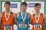 26 March 2017; U17 Men's Long Jump medallists, from left, Joseph McEvoy of Nenagh Olympic, Co. Tipperary, bronze, Darragh Miniter of St Mary's AC, Co. Clare, gold and Sean Carolan of Nenagh Olympic AC, Co. Tipperary, silver, during the Irish Life Health Juvenile Indoor Championships 2017 day 2 at the AIT International Arena in Athlone, Co. Westmeath. Photo by Sam Barnes/Sportsfile