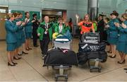 25 March 2017; Aer Lingus cabin crew welcome home Team Ireland's Richard Moran, a member of COPE Foundation Cork Special Olympics Club, from Crosshaven, Co. Cork, left, Caolan McConville, a member of Skiability Special Olympics Club, from Aghagallon, Co. Armagh, and Head of Delegation Karen Coventry as Team Ireland returned from the 2017 Special Olympics World Winter Games in Graz, Austria, at Dublin Airport in Dublin. Photo by Ray McManus/Sportsfile