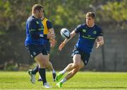 27 March 2017; Garry Ringrose, right, of Leinster passes to team-mate Mike Ross during a Leinster rugby squad training session at Rosemount, UCD, in Dublin. Photo by Brendan Moran/Sportsfile