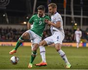 28 March 2017; Shane Long of Republic of Ireland in action against Holmar Eyjolfsson of Iceland during the International Friendly match between the Republic of Ireland and Iceland at the Aviva Stadium in Dublin. Photo by David Maher/Sportsfile
