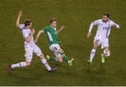 28 March 2017; Eunan O'Kane of Republic of Ireland in action against Jon Dadi Bodvarsson, left, and Arnor Smarason of Iceland during the International Friendly match between the Republic of Ireland and Iceland at the Aviva Stadium in Dublin. Photo by Eóin Noonan/Sportsfile