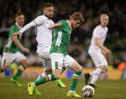28 March 2017; Eunan O'Kane of Republic of Ireland in action against Arnor Smarason of Iceland during the International Friendly match between the Republic of Ireland and Iceland at the Aviva Stadium in Dublin. Photo by Cody Glenn/Sportsfile