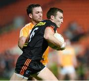 25 March 2017; Brendan Donaghy of Armagh in action against Patrick Gallagher of Antrim during the Allianz Football League Division 3 Round 6 game between Armagh and Antrim at Athletic Grounds in Armagh. Photo by Oliver McVeigh/Sportsfile