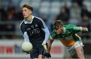 29 March 2017; Evan Comerford of Dublin gets past Adam Mahon of Offaly during the EirGrid Leinster GAA Football U21 Championship Final match between Dublin and Offaly at O'Moore Park in Portlaoise, Co Laois. Photo by Piaras Ó Mídheach/Sportsfile