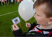 31 March 2017; A young Derry city fan holds a card   in memory of their former captain Ryan McBride prior to the SSE Airtricity League Premier Division match between Derry City and Bray Wanderers at Maginn Park in Buncrana, Co. Donegal. Photo by Oliver McVeigh/Sportsfile