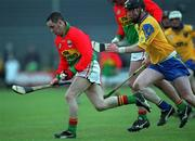 14 April 2002; Gary Doyle, Carlow, in action against Mickey Cunniffe, Roscommon. Carlow v Roscommon, National Hurling League Division 2 relegation play-off, Cusack Park, Mullingar. Picture credit; Aoife Rice / SPORTSFILE