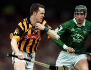 21 April 2002; Michael Kavanagh, Kilkenny, in action against Mark Keane, Limerick. Kilkenny v Limerick, Allianz National hurling league Semi Final, Gaelic Grounds, Limerick. Picture credit; Damien Eagers / SPORTSFILE