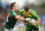 2 April 2017; Jamie Brennan of Donegal in action against Andy Moran of Mayo during the Allianz Football League Division 1 Round 7 match between Mayo and Donegal at Elverys MacHale Park in Castlebar, Co Mayo. Photo by Stephen McCarthy/Sportsfile
