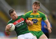 2 April 2017; Cillian O'Connor of Mayo in action against Hugh McFadden of Donegal during the Allianz Football League Division 1 Round 7 match between Mayo and Donegal at Elverys MacHale Park in Castlebar, Co Mayo. Photo by Stephen McCarthy/Sportsfile