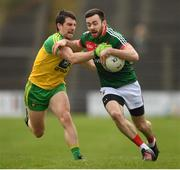2 April 2017; Kevin McLoughlin of Mayo in action against Paddy McGrath of Donegal during the Allianz Football League Division 1 Round 7 match between Mayo and Donegal at Elverys MacHale Park in Castlebar, Co Mayo. Photo by Stephen McCarthy/Sportsfile