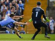 2 April 2017; Jack McCarron of Monaghan shoots to score his side's first goal despite the tackle of David Byrne of Dublin during the Allianz Football League Division 1 Round 7 match between Monaghan and Dublin at St. Tiernach's Park in Clones, Co Monaghan. Photo by Philip Fitzpatrick/Sportsfile