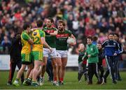 2 April 2017; Aidan O'Shea and Tom Parsons, left, of Mayo exchange views with Eóin McHugh, left, and Patrick McBrearty of Donegal as supporters come onto the pitch prior to the final whistle during the Allianz Football League Division 1 Round 7 match between Mayo and Donegal at Elverys MacHale Park in Castlebar, Co Mayo. Photo by Stephen McCarthy/Sportsfile