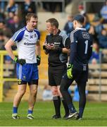 2 April 2017; Match referee Joe McQuillan speaks to Jack McCarron, left, of Monaghan and Dublin captain Stephen Cluxton before issuing both a yellow card during the Allianz Football League Division 1 Round 7 match between Monaghan and Dublin at St. Tiernach's Park in Clones, Co Monaghan. Photo by Ray McManus/Sportsfile