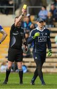 2 April 2017; Match referee Joe McQuillan issues  Dublin captain Stephen Cluxton with a yellow card during the Allianz Football League Division 1 Round 7 match between Monaghan and Dublin at St. Tiernach's Park in Clones, Co Monaghan. Photo by Ray McManus/Sportsfile