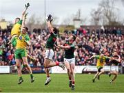 2 April 2017; Tom Parsons and Stephen Coen, right, of Mayo in action against Michael Langan, left, and Ciaran Thompson of Donegal during the Allianz Football League Division 1 Round 7 match between Mayo and Donegal at Elverys MacHale Park in Castlebar, Co Mayo. Photo by Stephen McCarthy/Sportsfile