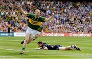 3 August 2009; Colm Cooper, Kerry, celebrates scoring his side's first goal past Stephen Cluxton, Dublin. GAA Football All-Ireland Senior Championship Quarter-Final, Dublin v Kerry, Croke Park, Dublin. Picture credit: Stephen McCarthy / SPORTSFILE