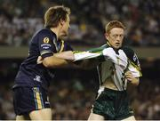 28 October 2005; Colm Cooper, Ireland, is tackled by Dale Morris, Australia. 2005 Fosters International Rules Series, game 2, Australia v Ireland, Telstra Dome, Melbourne, Australia. Picture credit; Ray McManus / SPORTSFILE