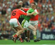 22 September 2002; Colm Cooper, Kerry, is tackled by Kieran McGeeney (6) and Enda McNulty, Armagh. Kerry v Armagh, All Ireland Football Final, Croke Park, Dublin. Picture credit; Ray McManus / SPORTSFILE