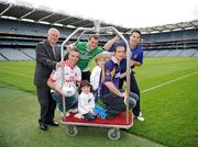 20 September 2011; Four year old Lucy O'Neill and five year old Conall Woods, from Clontarf, Dublin, with Uachtarán Chumann Lúthchleas Gael Criostóir Ó Cuana, Padraic Joyce, Killererin, Galway, Michael Murphy, Glenswilly, Co. Donegal, Ryan O'Dwyer, Kilmacud Crokes, Dublin, and Ronan Curran, St Finbarr's, Cork, at the Croke Park Hotel and Croke Park Conference Centre GAA Club Support Programme launch. Croke Park, Dublin. Picture credit: Ray McManus / SPORTSFILE